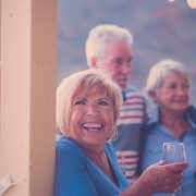 No age limit for new mortgages, older people enjoying party on veranda