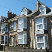 Buy to let landlords face increasing challenges, terraced houses in sunshine